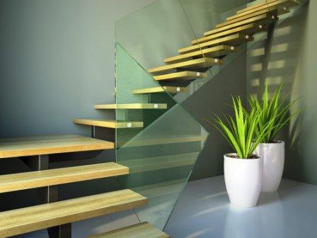 Páteřové schodiště s dřevěnou stupnicí a skleněným zábradlím