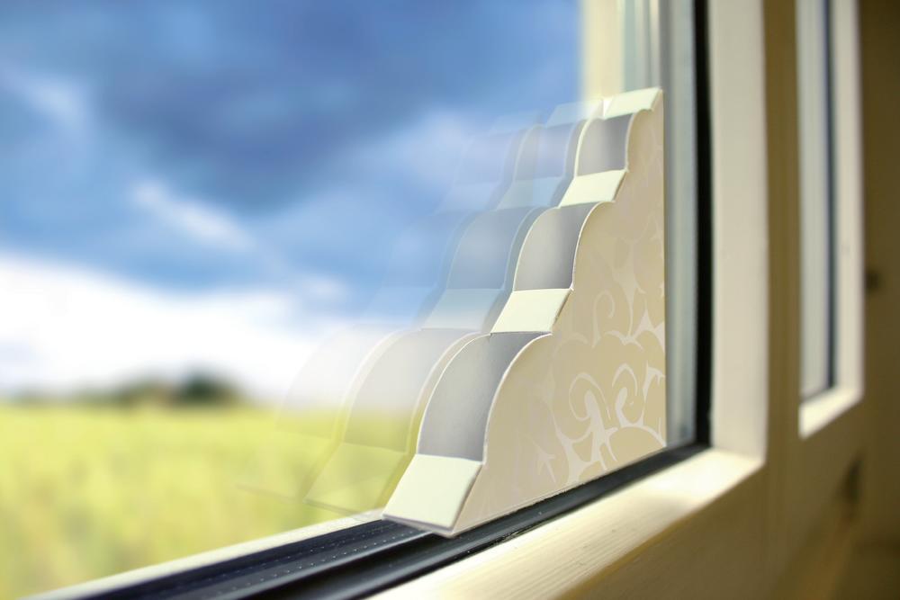 Rohová mucholapka do okna